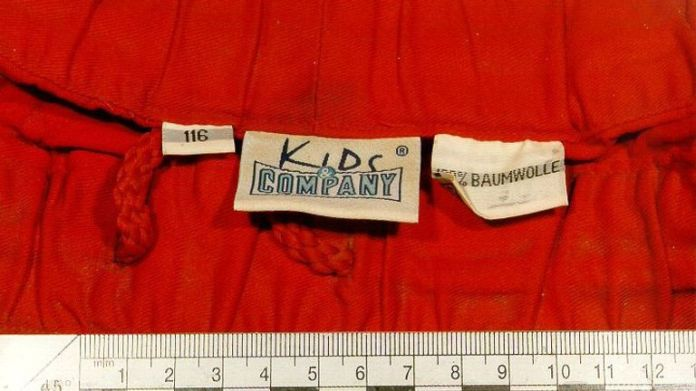 The label in a pair of orange shorts, found on the torso of a young boy which was discovered floating in the River Thames, on Friday afternoon. Detective Superintendent Adrian Maybanks, leading the investigation in the boy's death, said the butchered body. * ... , spotted by a member of the public who was crossing Tower Bridge, was of an Afro-Caribbean child aged around five-and-a-half. * who was crossing Tower Bridge, was of an Afro-Caribbean child aged around five-and-a-half. 02/07/03 :
