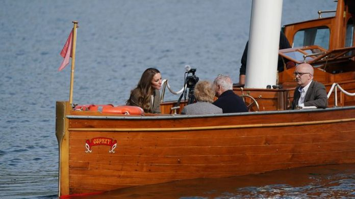 The Duchess of Cambridge travels in the steam launch Osprey on Windermere from Wray Castle, ahead of a meeting with relatives of the Windermere Children to learn about how their loved ones' time in Cumbria recuperating after World War Two helped them to go on to build successful lives in the UK. Picture date: Tuesday September 21, 2021.