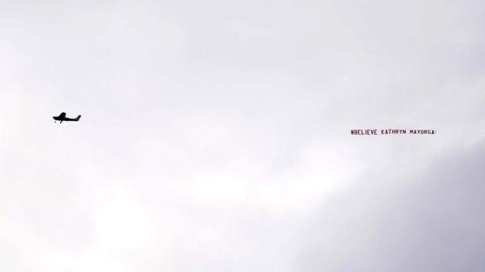 "A banner reading ""#Belive Kathryn Mayorga' flew over Old Trafford"