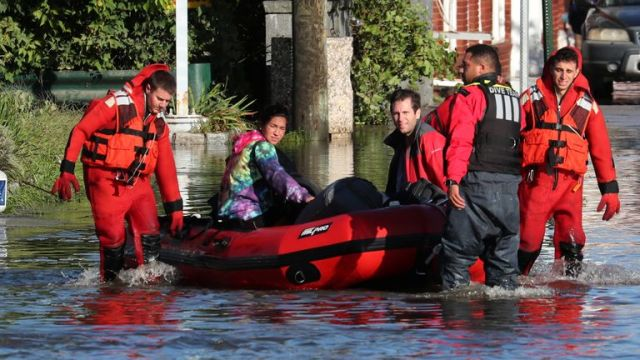 First responders pull local residents to safety in Mamaroneck, New York