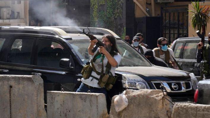 Pic: AP Supporters of a Shiite group allied with Hezbollah fire weapons during armed clashes that erupted during a protest in the southern Beirut suburb of Dahiyeh, Lebanon, Thursday, Oct. 14, 2021. It was not immediately clear what triggered the gunfire, but tensions were high along a former civil war front-line between Muslim Shiite and Christian areas. (AP Photo/Hassan Ammar)