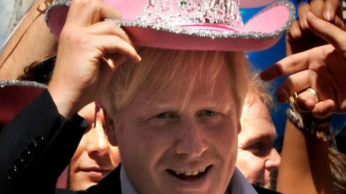 London Mayor Boris Johnson wears a pink cowboy hat at the Pride London parade in central London.