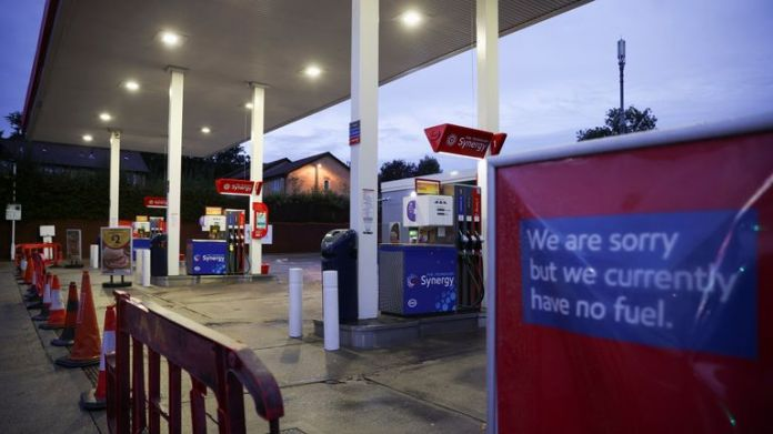 A sign informing customers that fuel has run out is pictured at an Esso fuel station in south London, Britain, October 5, 2021. REUTERS/Hannah McKay