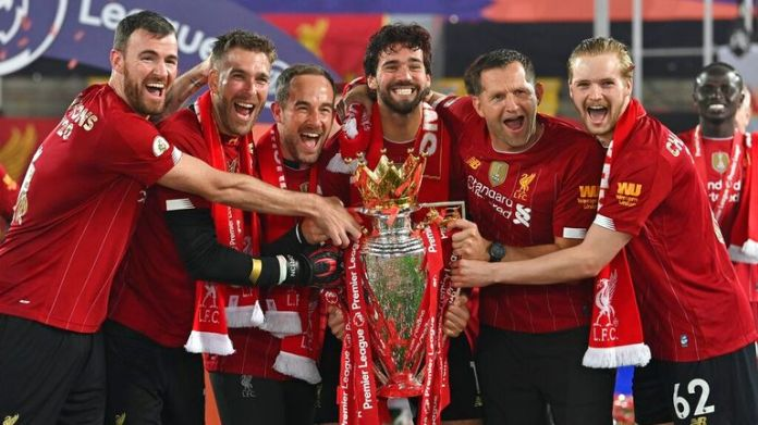 Players celebrate their Premier League win last year. Pic: AP