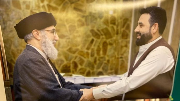 Waheed Totakhyl has this picture on his office wall of him meeting Gulbuddin Hekmatyar, aka the 'Butcher of Kabul'