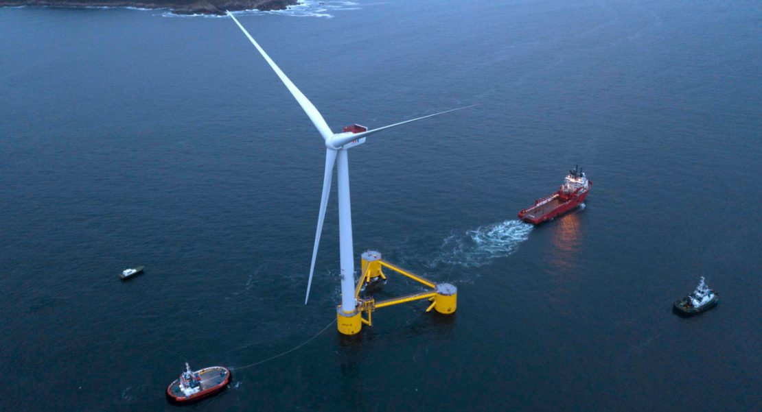 A floating turbine being pulled out to sea off the coast of Portugal