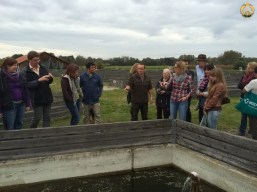 "Excursion the group visiting the experimental fish farm site ""LFU Wielenbach"" in Wielenbach."