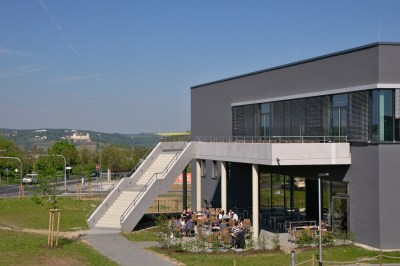 the university cafeteria with a view of the castle