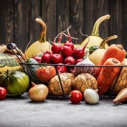 Wire basket full of fresh vegetables