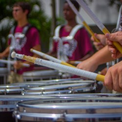 (Photo Gallery) Drum line and color guard give pre-game performance to boost spirit