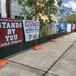 Banners from Broward County schools and organizations around the country decorate the fence surrounding the perimeter of the 1200 building.