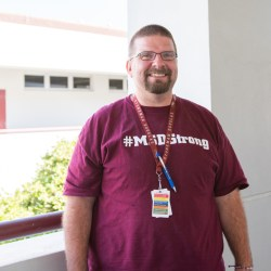 Social studies teacher Ernie Rospierski smiles in his #MSDStrong shirt at MSD. Photo by Suzanna Barna