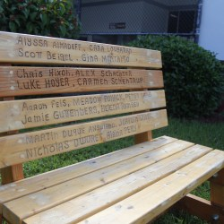 Captivating Change. The memorial bench, one of the new additions to the school campus, is displayed in the courtyard. Photo by Nyan Clarke