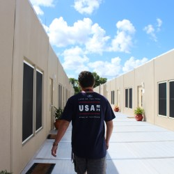 Taking a Stroll. Junior Harris Jaffe walks back to his 8th period debate class in Eagle Village. Photo by Rebecca Schneid