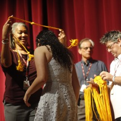 Principal Hall presents graduating class with cords for upcoming graduation. Photo by Kaleela Rosenthal