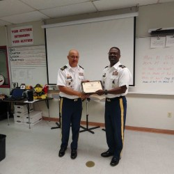 Sergeant First Class Ramon Arias presented a Silver Instructor Award certificate by the Department of the Army