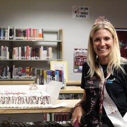 Principal Michelle Kefford stands in front of her 25th birthday cake. Photo by Bianca Navas