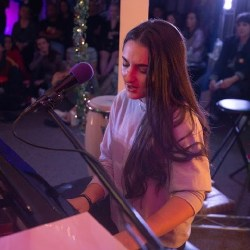 Sophomore Ayla Bogart sings at one of her gigs. Photo courtesy of Ayla Bogart