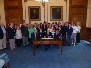 Governor signing the Indiana Common Core bill
