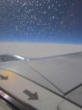 Frost on the outside of the airplane window