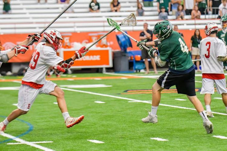 Fayetteville-Manlius junior attacker Donovan Welsh (4) scores the game-winning goal with 31.3 seconds left as the Hornets beat Baldwinsville 8-7 in Saturday's Section III Class A final at the Carrier Dome. Welsh played with a heavy heart, having his lost his father to liver cancer a week ago.