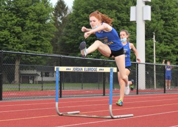 Cazenovia girls track and field runner Melanie Michael was victorious in both the 100 and 400-meter hurdles in last Wednesday's meet against Jordan-Elbridge, where the undefeated Lakers prevailed  93-47 over the Eagles.