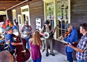 a group of bluegrass musicians jamming