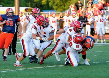 Baldwinsville defenders Collin Stanley (39), Dan Ewald (44) and Amari Akins (26) combine to tackle Liverpool's Dakari Mack in last Friday's game, where the Bees beat the Warriors 20-14 to improve to 3-0 on the season.