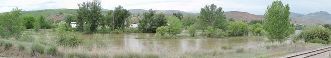 The Okanogan River has risen to minor flood stage in the Tonasket area. NationalWeather Service officials have issued a flood warning for the Okanogan Valley.