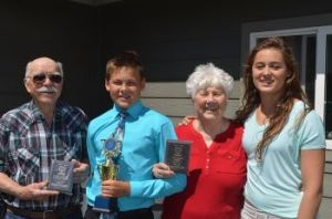 grandparents and two children, with awards