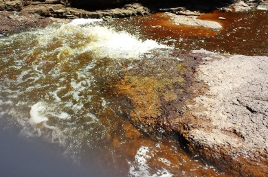 Water rushing over shallow falls at Gooseberry Falls State Park MN