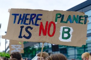 "Protester holding sign ""there is no planet B"""