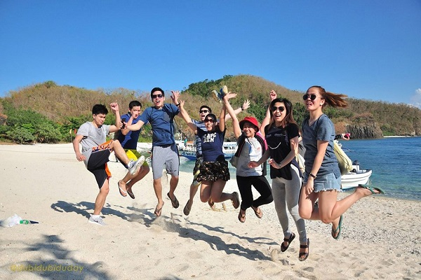 Group of friends on a jumpshot along the beach