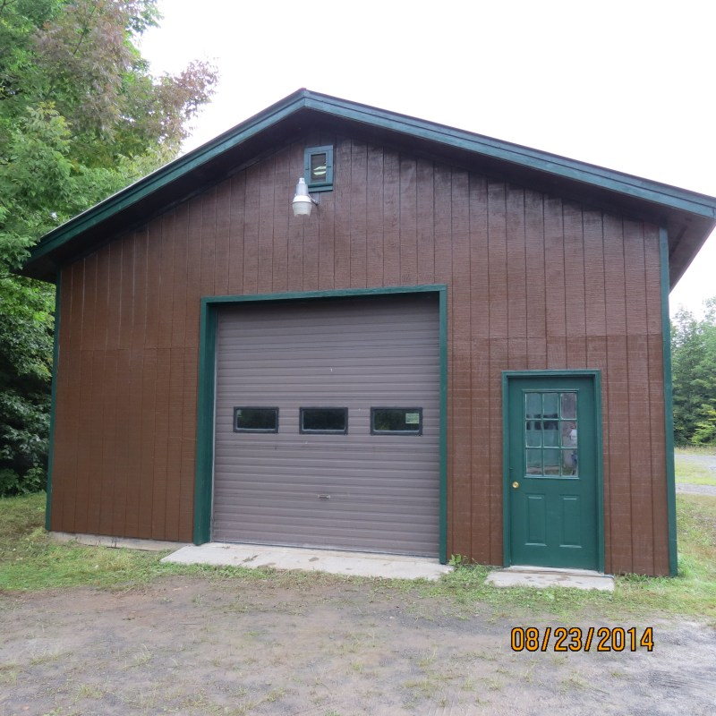 Painting and Restoring the Bundle-wood Shed at Highland Forest