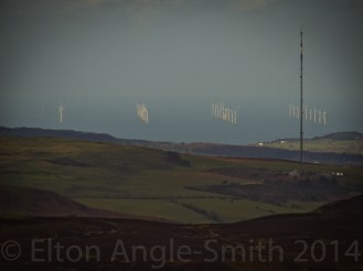 Looking North West to the perfectly straight lines of the Rhyl Flats wind turbines; this is a greatly magnified shot