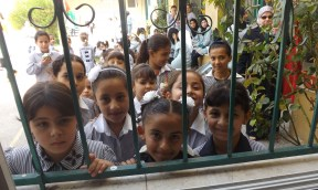 A common site around the world, kids are all smiles as the wait for the day to start. School girls in Nazlat 'Isa. Photo EAPPI/L. dos Santos
