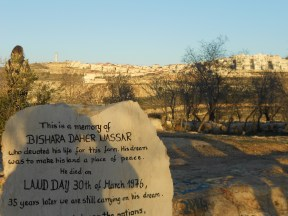 A dedication to Daher's father who founded the Tent of Nations. The settlement of Neve Daniel is in the background. Photo EAPPI/E. Goebel.