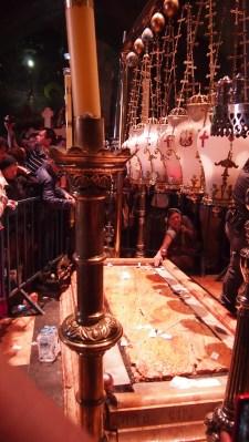 Women pray inside the Holy Sepulchre on Good Friday. Photo EAPPI/J. Valkama.