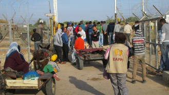 Workers and farmers wait at Far'un gate in order to enter and cultivate their land. Photo EAPPI/D. Montagut.