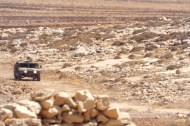 One of 3 Israeli army jeeps drives towards Tawayel, 10 September 2014. Photo EAPPI/N. Ray.