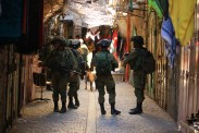05.09.15. Hebron, Old City. Soldiers patrolling the souq during Settlers Tour. Photo EAPPI/R. Leme