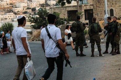25.08.15 Hebron H2, Settlers protected by soldiers walking to synagogue on the 'prayer road'. Photo EAPPI/R. Leme