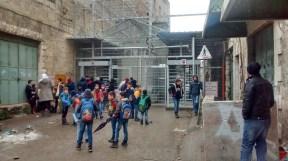 Children waiting outside Checkpoint 56 Hebron H2. EAPPI/M. Botelho 30.12.15
