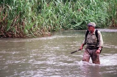 David Billings crossing a river in East New Britain in his undaunted search for the plane.