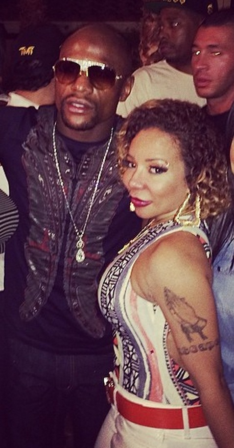 Rapper TI fights Floyd Mayweather over his wife, Tiny