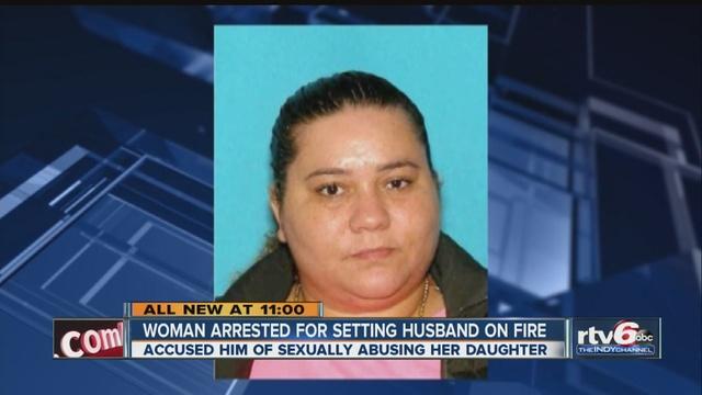 woman set husband on fire