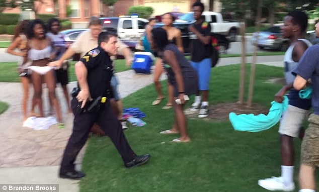White Police Caught On Camera Pointing Gun At African American Children During Pool Party; Officer Suspended