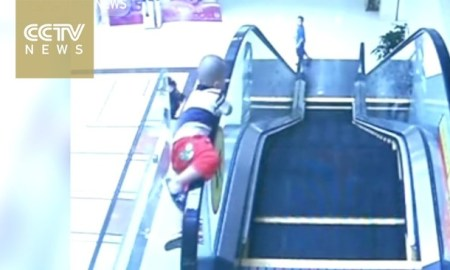 Asian Child Falls From Escalator Smashing To Ground Beneath! [ Live Video]