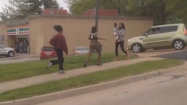Teenage Girl Attacked by Several Girls While Holding A Baby