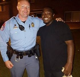 Police Post Photo of Himself With Man Who Tried To Stab Him & It Goes Viral